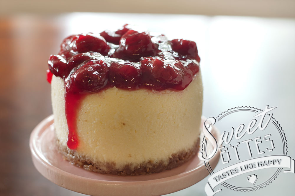 A mini-cheesecake with cherry topping dripping down the left side for article about baking terminologyl