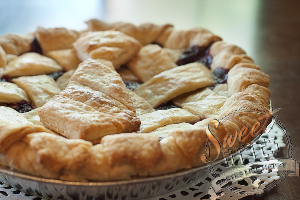 A triple berry pie with a pie crust cut out in the shape of a man's tie