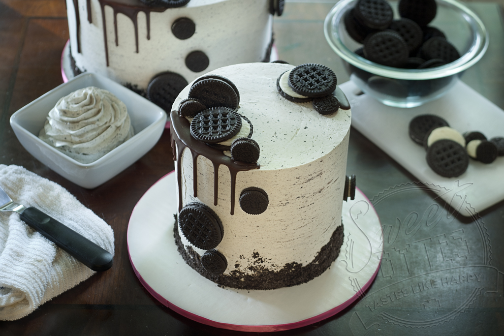 Small cookies and cream cake with cookies artfully arrange on cake