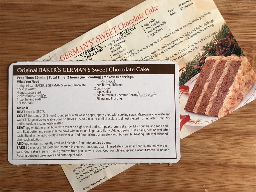 How to read a recipe using the recipe card for Original Baker's German's Chocolate cake arranged on top of another recipe card. The bottom recipe card has a picture of a slice of German Chocolate cake.