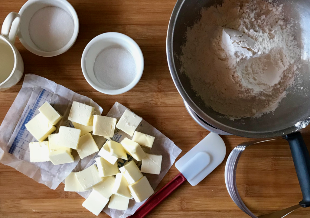 baking ingredients and ready to soften butter on a cutting board