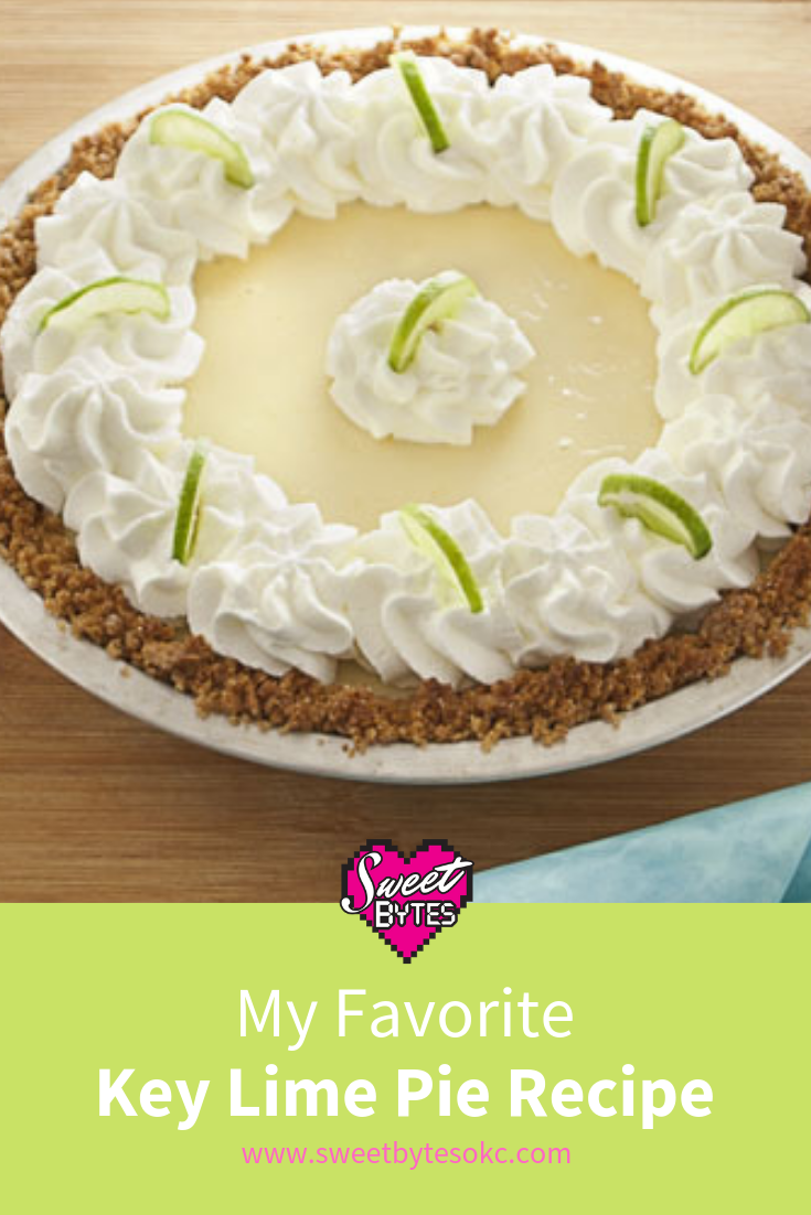 A baked key lime pie with whipped cream on an image to save on pinterest