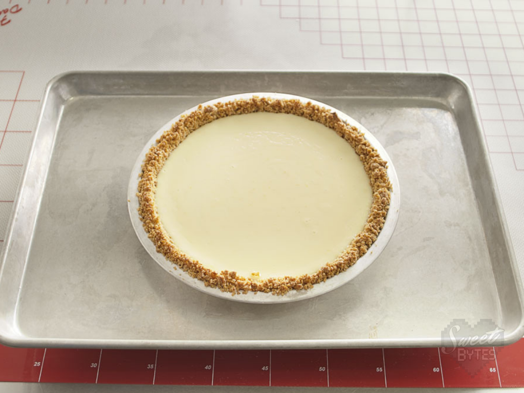 An unbaked key lime pie on a baking sheet