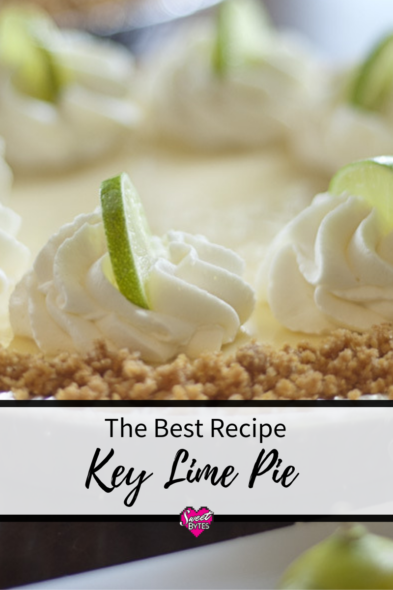 close up of the top of a key lime pie with whipped cream and key lime slices.