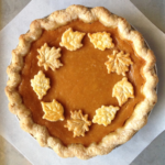 Overhead picture of pumpkin pie with a circle of pie crust leaves for decoration