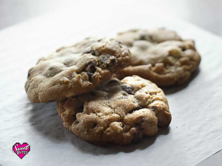 3 big triple chocolate chunk cookie arranged on a white parchment paper after baking cookies