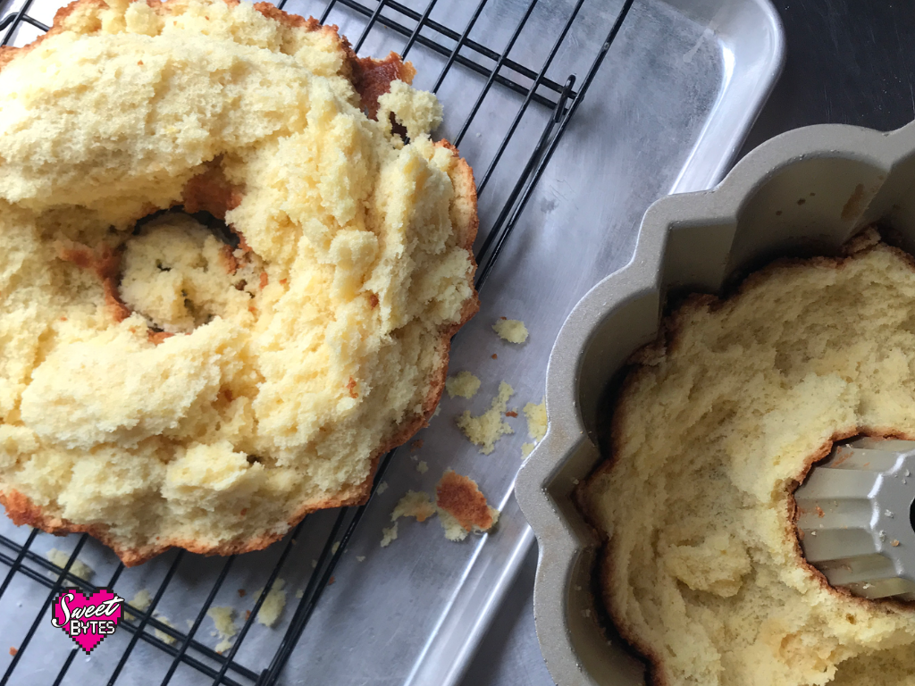A cake stuck in pan. Half on the cooling rack, half in the bundt pan.