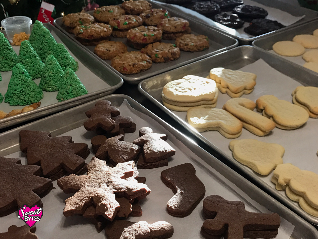 A table full of different types of Christmas cookies for December