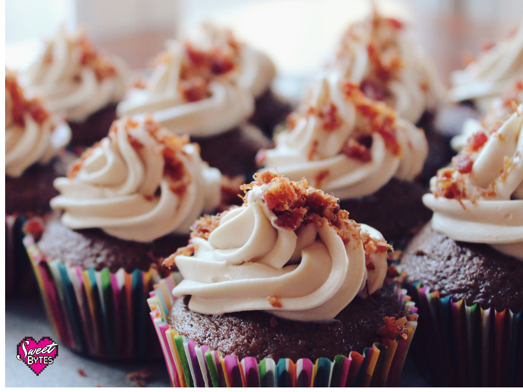 Cupcakes with swirled frosting and candy sprinkled on top.