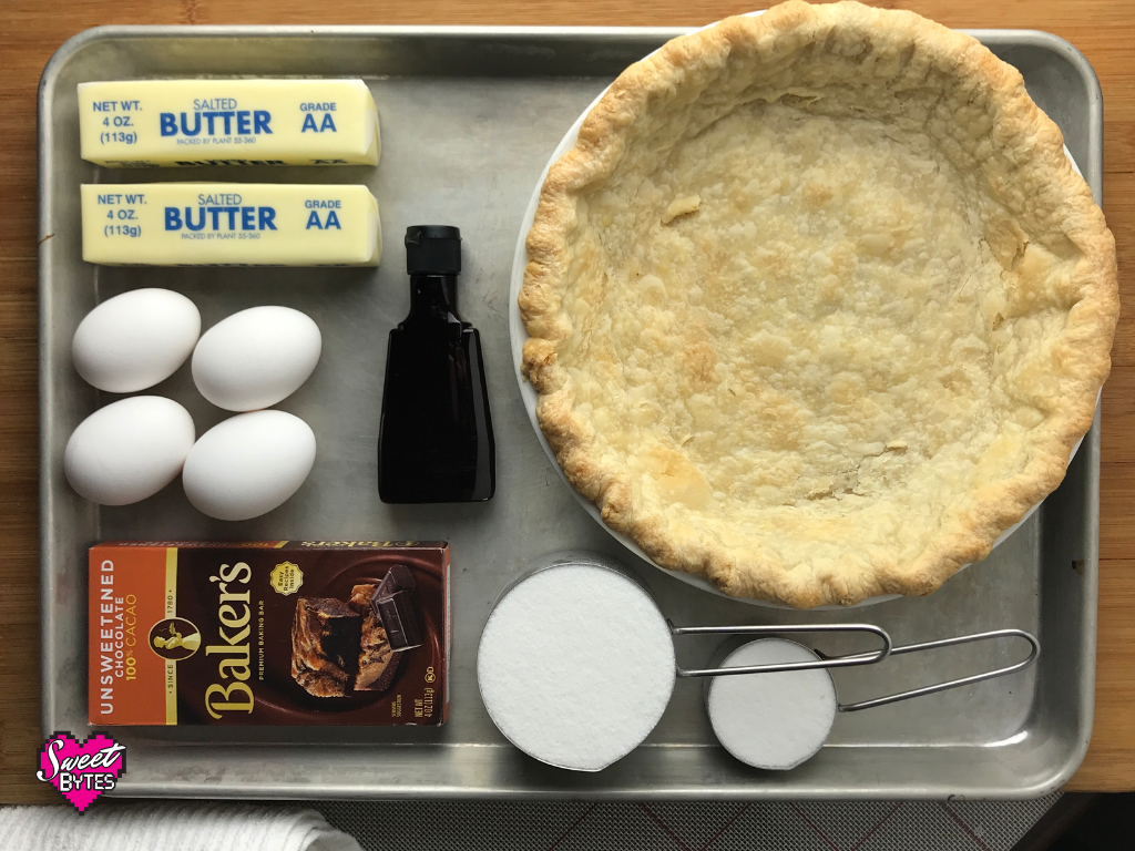The ingredients for French silk pie laid out neatly on a baking sheet.