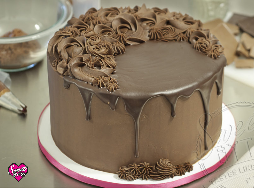 A chocolate cake covered in chocolate ganache