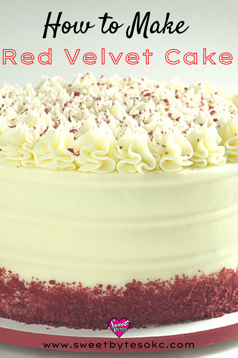 A close up of a beautiful red velvet cake with cake crumbs at the bottom and cream cheese frosting