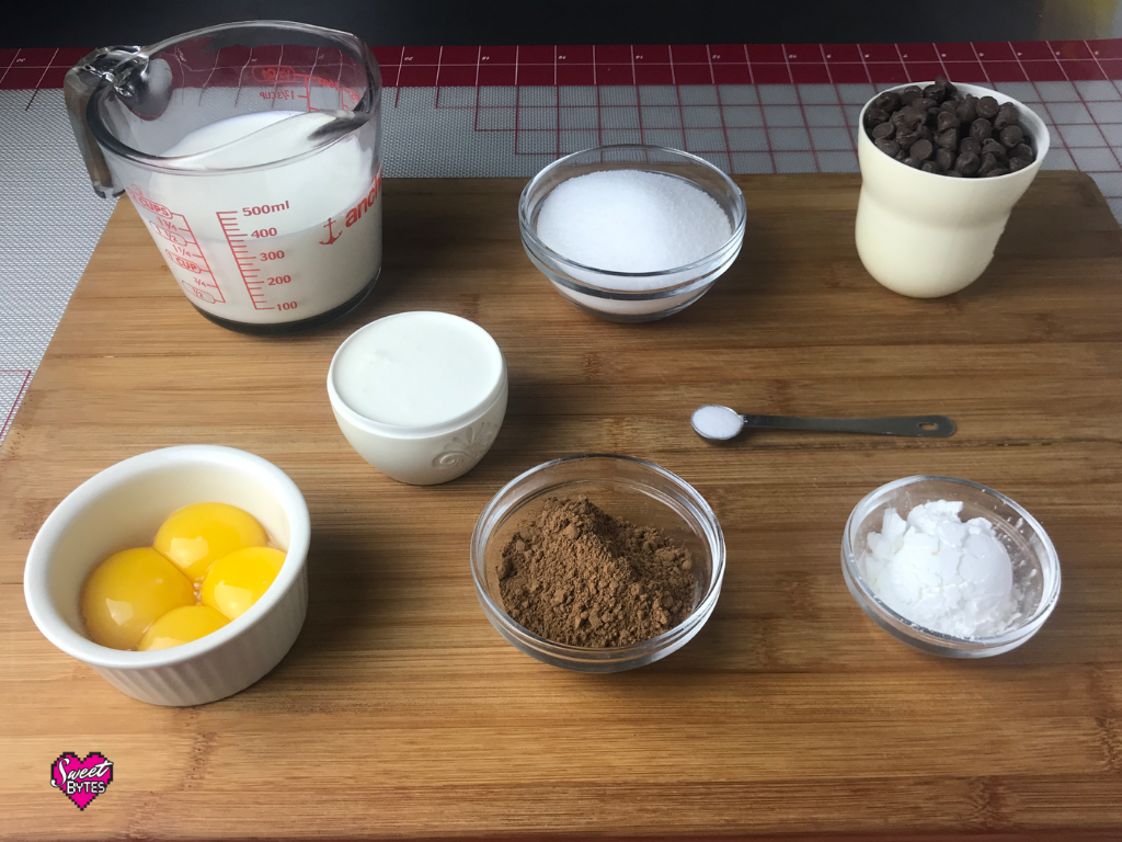 Ingredients for Thin Mint pie filling arranged on a wooden board