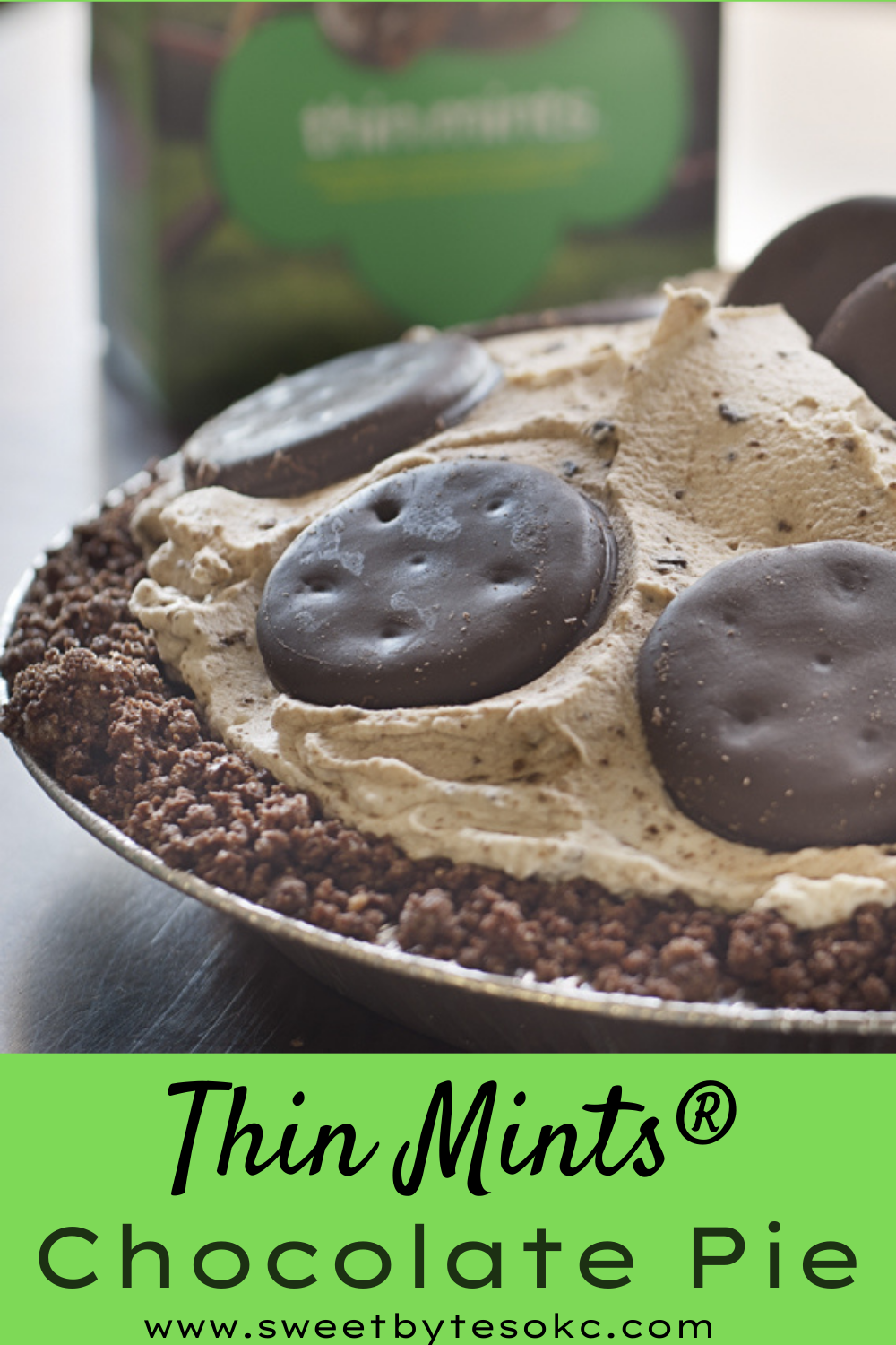 a chocolate pie made with thin mints girl scout cookies and a box of thin mints girl scout cookies in the background
