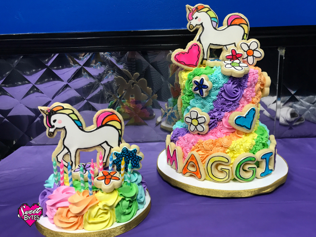 2 unicorn cakes with rainbow colored buttercream
