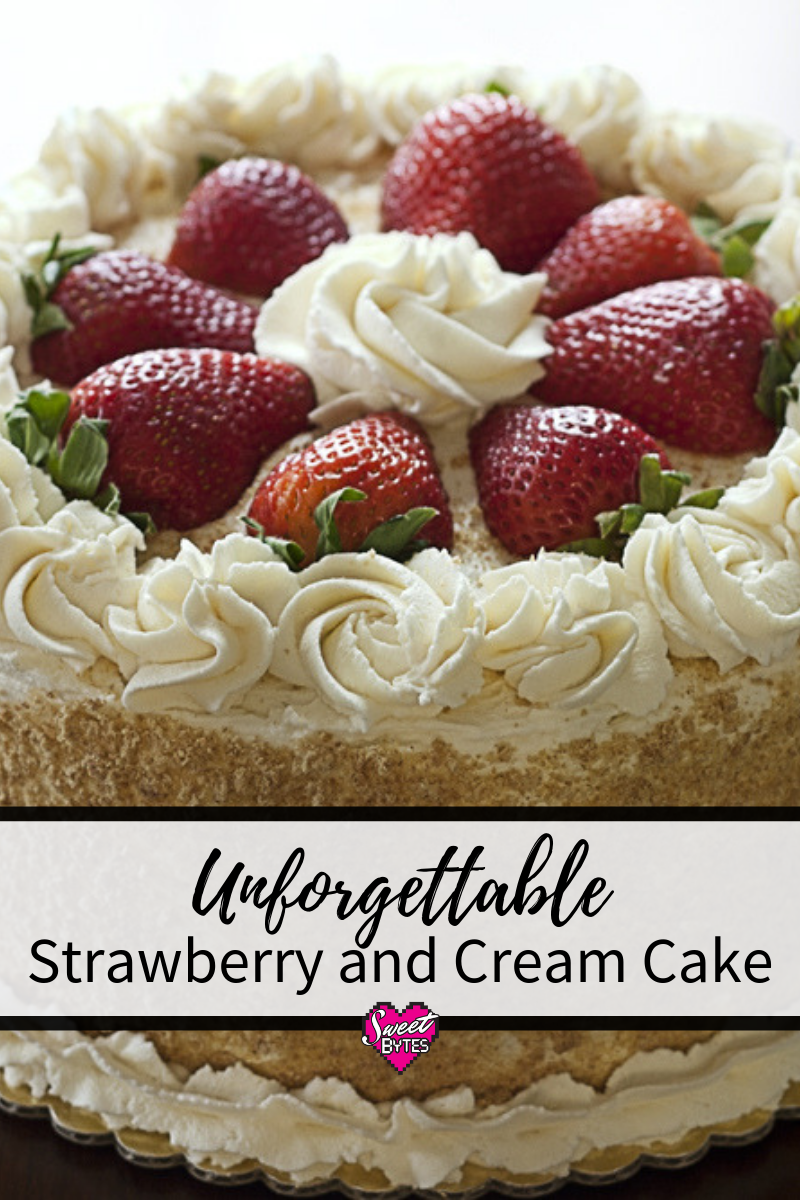 A top view of fully decorated strawberry and cream cake