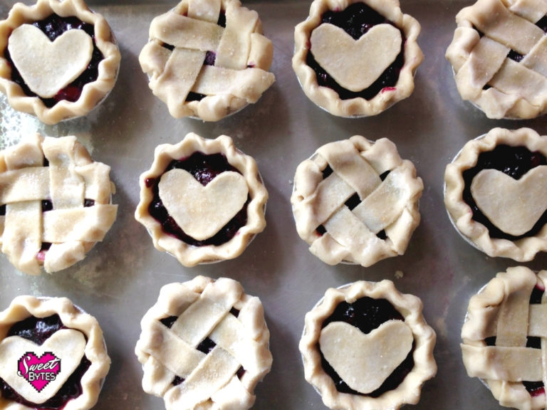 12 mini pies with alternating hearts and lattice using the best pie crust recipe