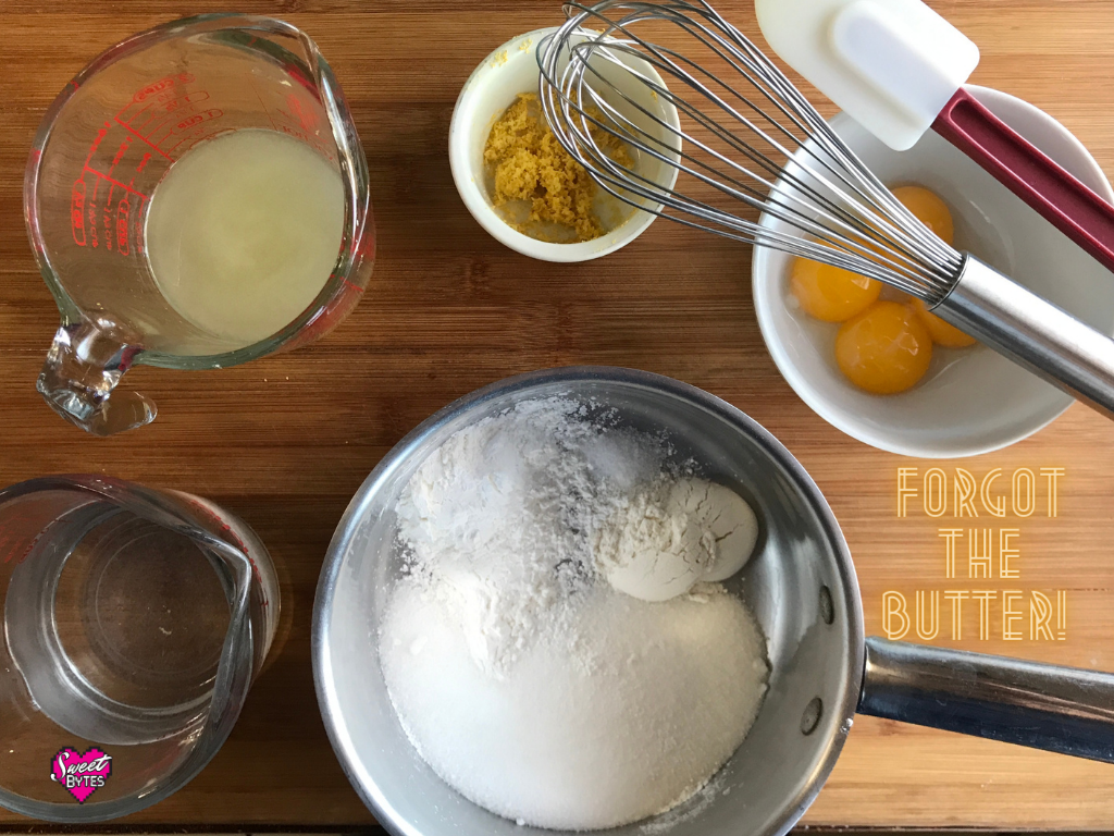 "Displayed ingredients for making lemon meringue pie filling: water, lemon juice, lemon zest, egg yolks, sugar, flour, cornstarch, and salt. Text on image says ""forgot the butter"""