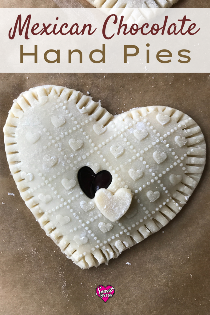 A heart-shaped Mexican chocolate hand pie on a brown parchment paper