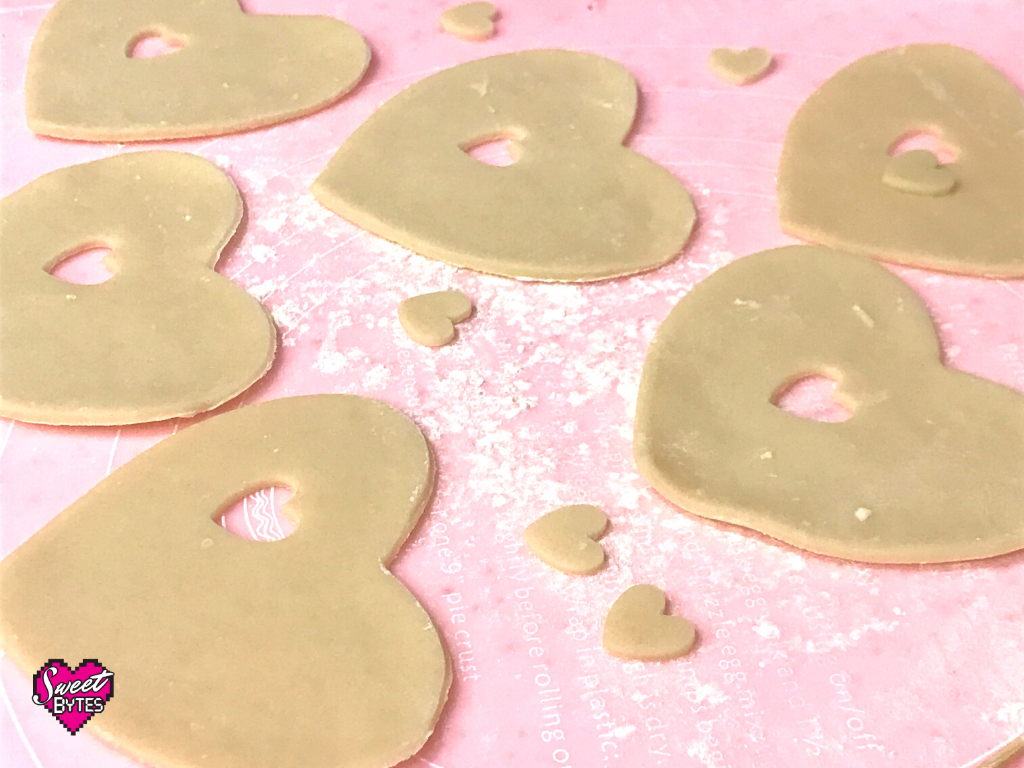 hearts cut out of pie crust to make heart-shaped hand pies