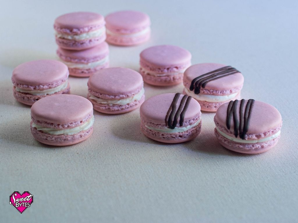 Pink French macarons on white table cloth
